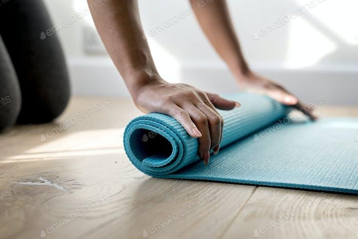 Woman Rolling Yoga-Matte