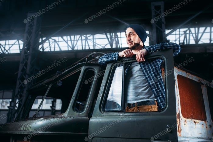 Stalker pose on abandoned military vehicle