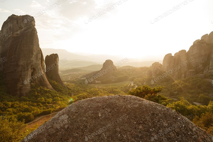 Pinnacles of rocks in Meteora landscape panorama at sunset, Greece