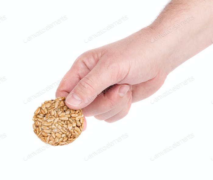 Candied roasted peanut seeds in hand.