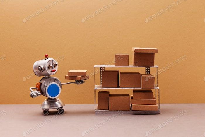 Four wheel robot packer storekeeper sorts parcels on shelves.