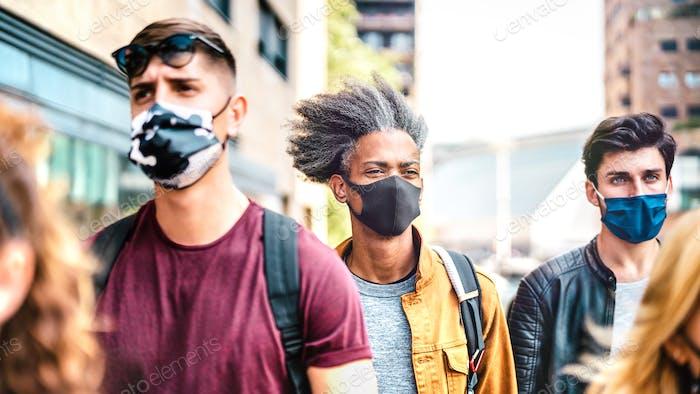 Multiracial crowd walking on city street