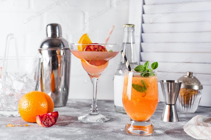 Paloma cocktail with fresh grapefruit, orange and mint
