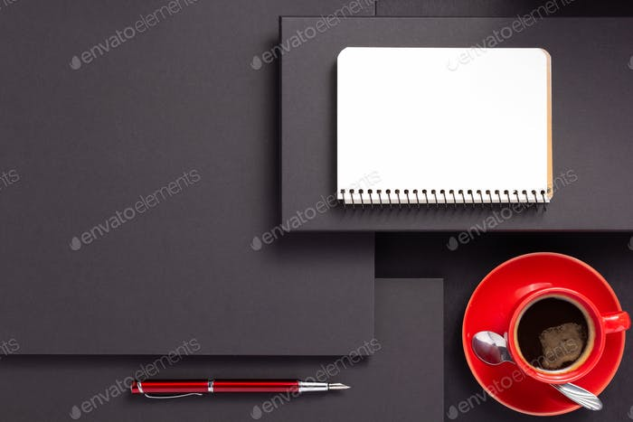 notebook with pen and cup of coffee