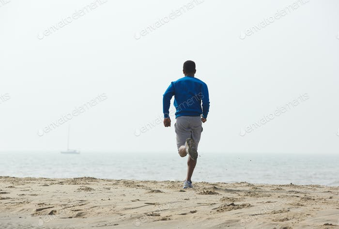 Rear view african american man running