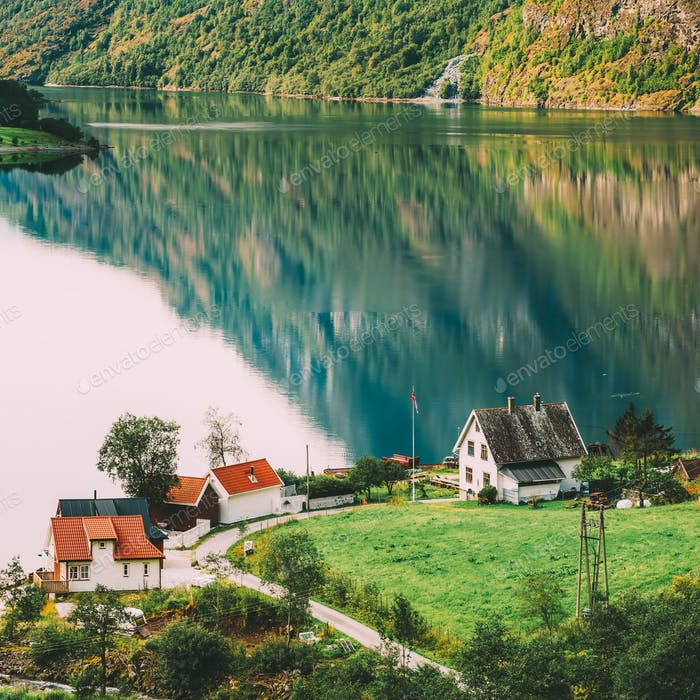 Scandinavian houses on shore of the narrowest fjord in Norway -