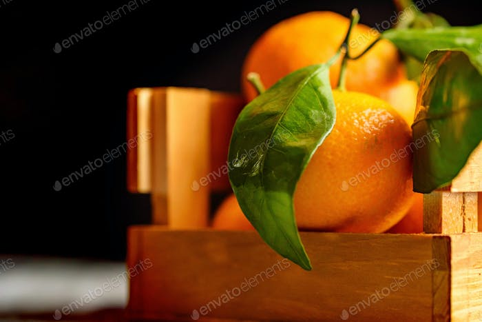Mandarine orange or tangerine on wooden board