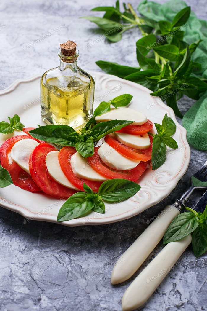 Italian caprese salad with mozzarella, tomatoes and basil