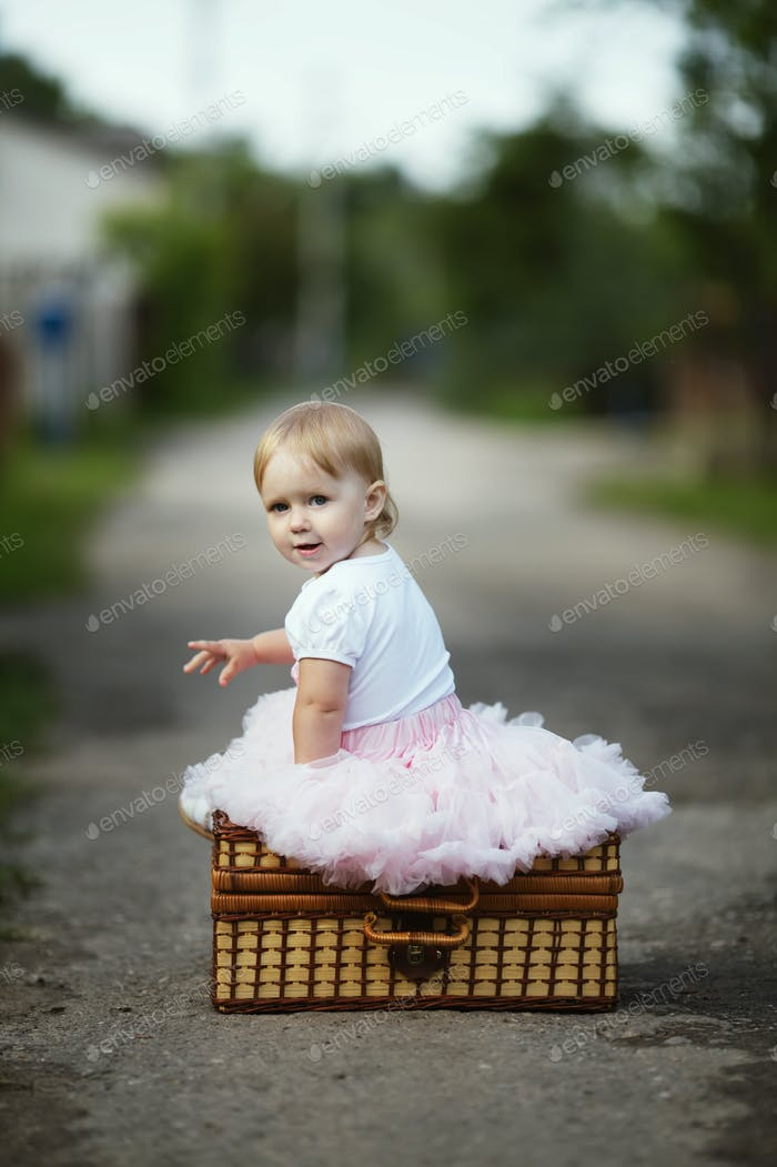 cute little girl with suitcase