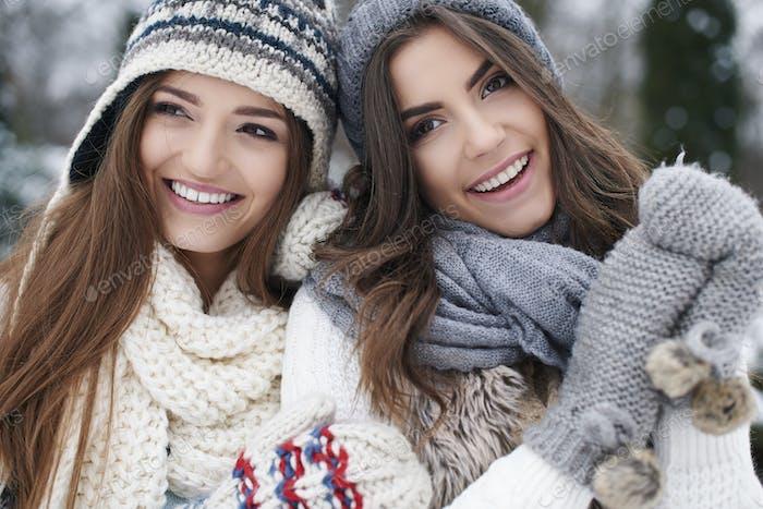 Winter portrait of fashion female friends