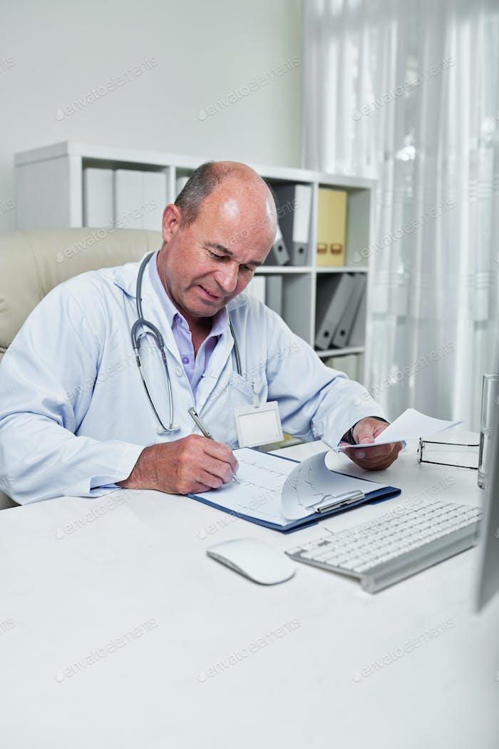 Cardiologist checking cardiogram