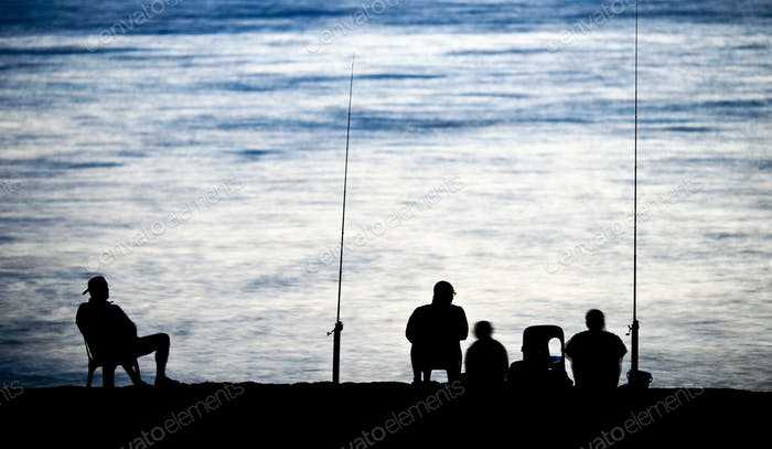 Sea/Ocean fishing - fishermen sitting by the sea/ocean in darkne
