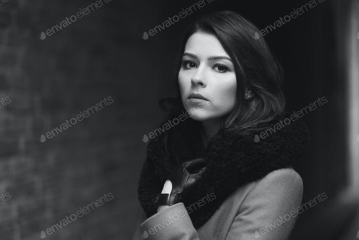 Charming fashion female modell in a coat.