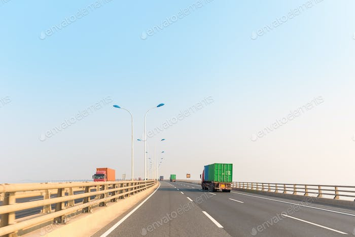 container trucks on cross-sea bridge