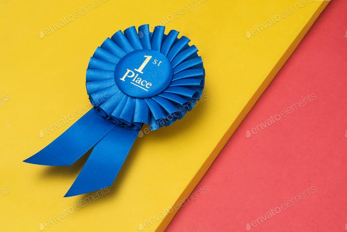 Rosette first place for the achievement and success of the winner on an illuminating background