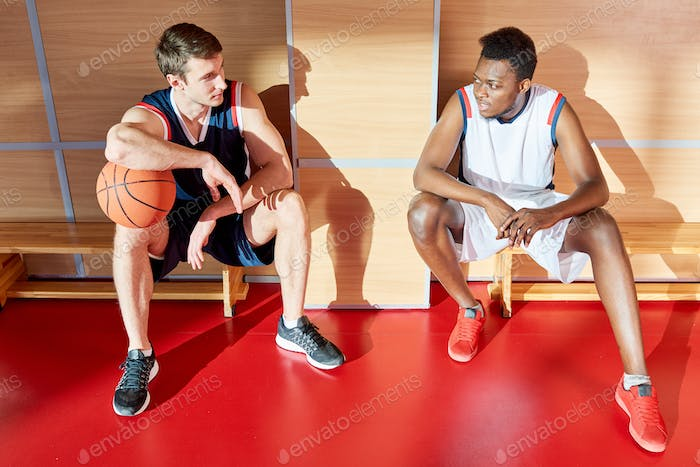 Basketball players sitting on benches