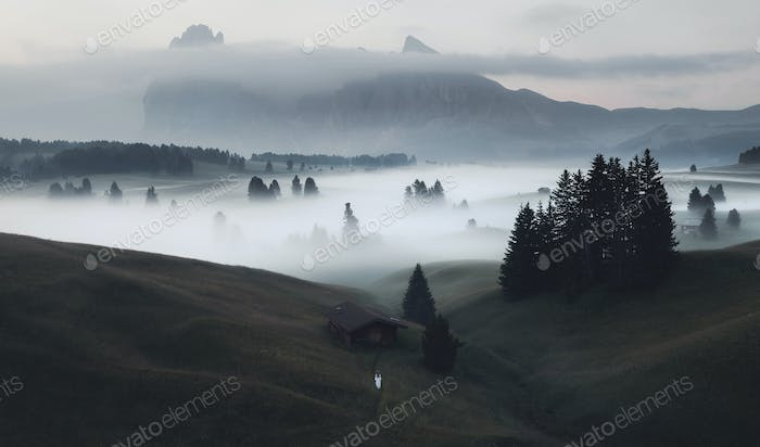 Mystical morning in the Dolomites mountains