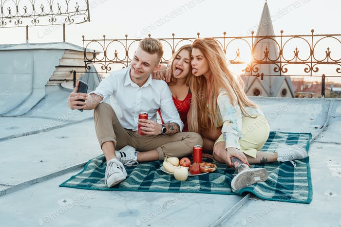 Carefree friends taking shot together at top
