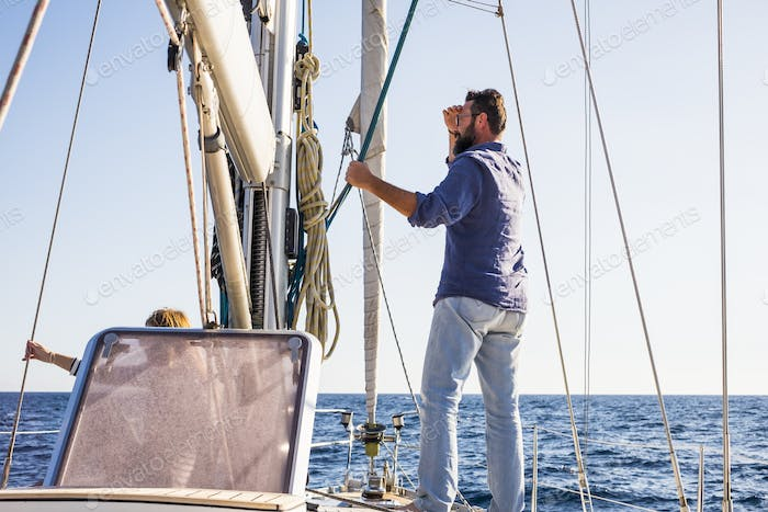 Man stand on a sail boat travel