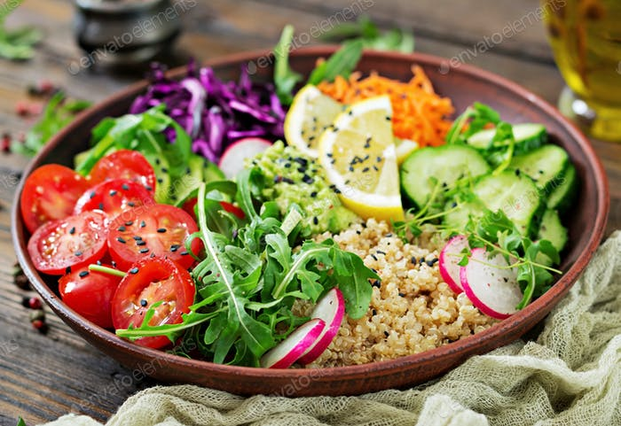 Vegetarian Buddha bowl with quinoa and fresh vegetables. Healthy food concept. Vegan salad.