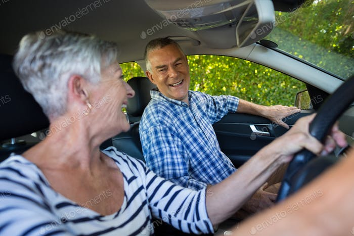 Senior couple sitting in car