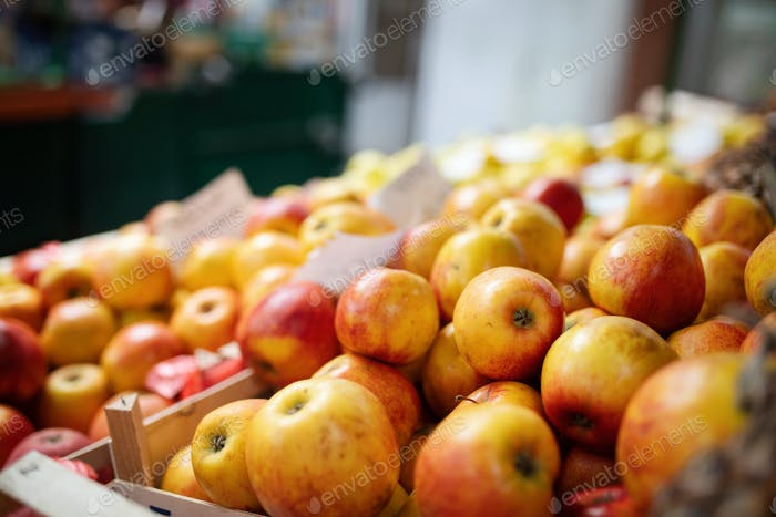 Fresh organic apple in market. Closeup background