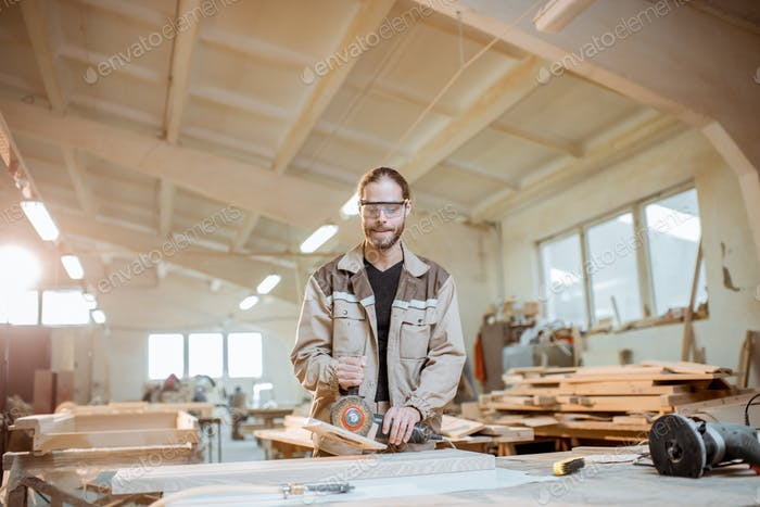 Worker at the carpentry manufacturing