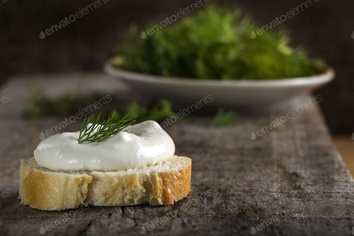 Fresh cream cheese on bread slice