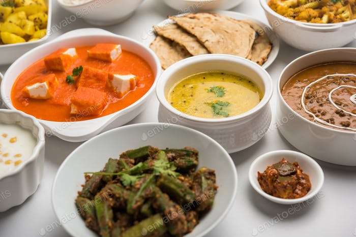 Indian assorted vegetarian food in plate and serving bowls