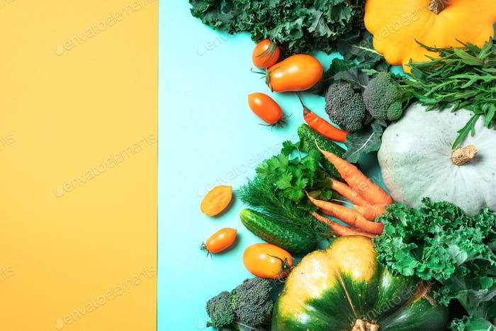 Autumn vegetables on trendy yellow and green background. Top view. Vegan and vegetarian diet