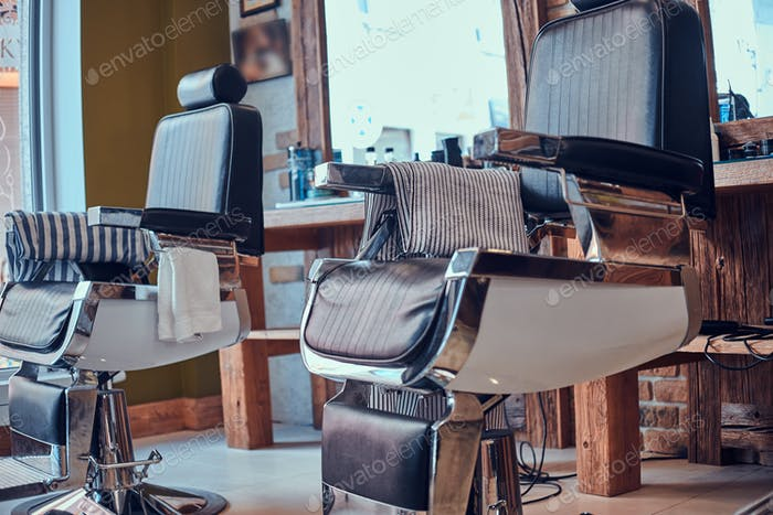 Interiour of luxury trandy barbershop in daylight.