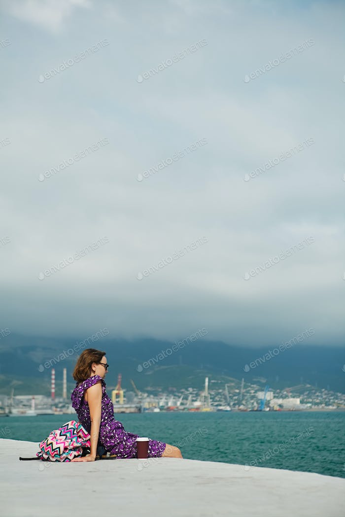 Woman enjoying seascape on waterfront