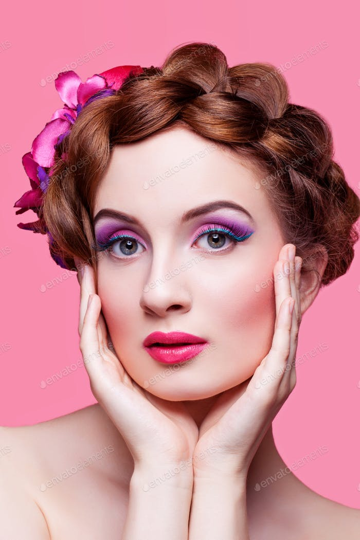 Beautiful girl with bright make-up and pink hat