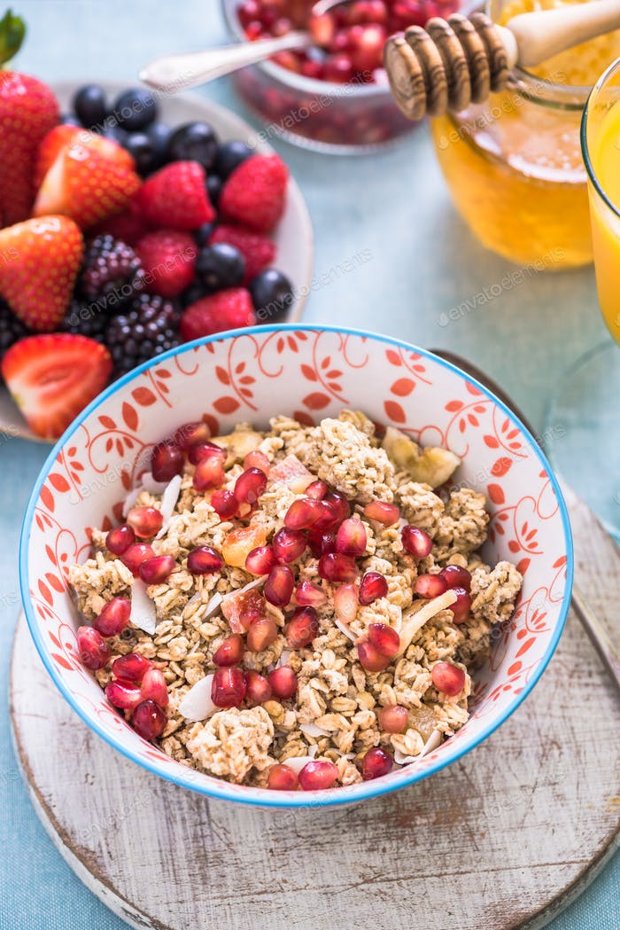 granola bowl with pommegranate seeds