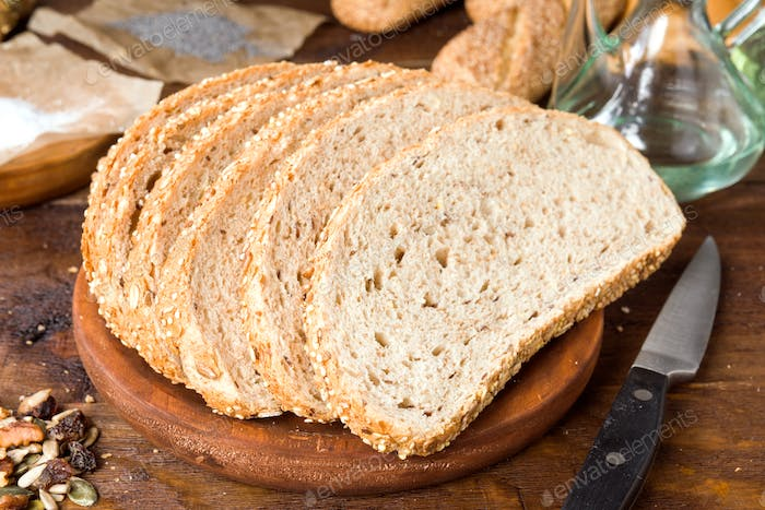 Seed bread slices, rustic wooden stage