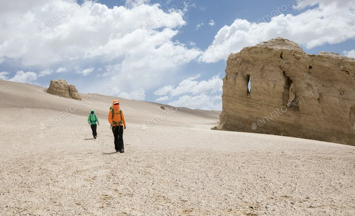 HikingTwo hikers hiking on sand desert