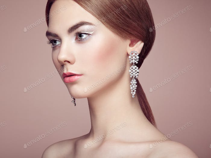 Fashion portrait of young beautiful woman with jewelry