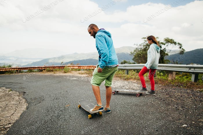 longboarding couple in tropics