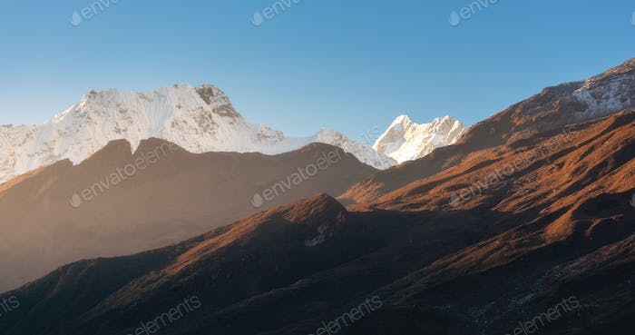 Beautiful mountains with snowy peaks at sunny morning in Nepal