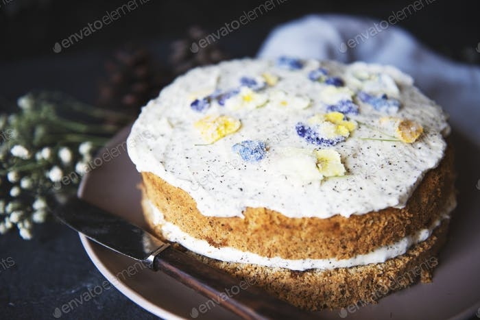 Sponge cake decorated with violets