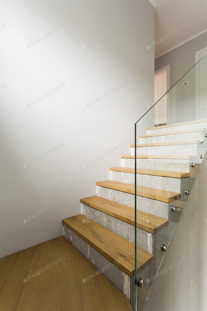 Concrete stairs in minimalist interior