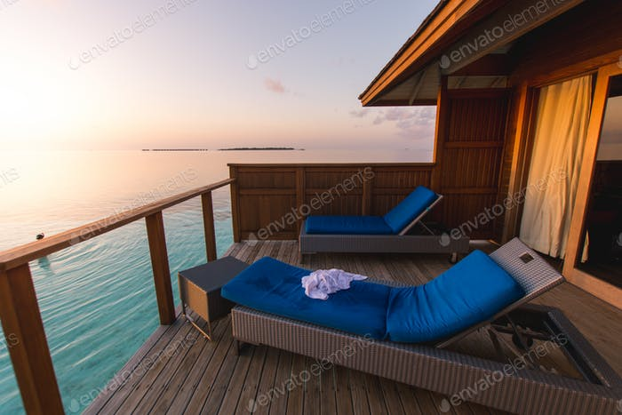 Beautiful tropical Maldives resort hotel and island with beach.
