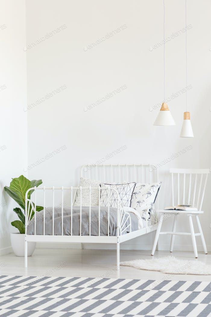White Chair Next To Bed In Bedroom Interior With Patterned Carpe Photo By Bialasiewicz On Envato Elements