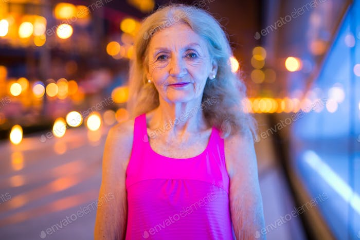 Portrait Of Senior Woman Outdoors At Night