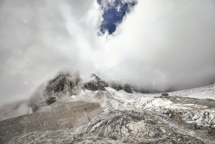 Jade Dragon Snow Mountain peak covered with clouds, China