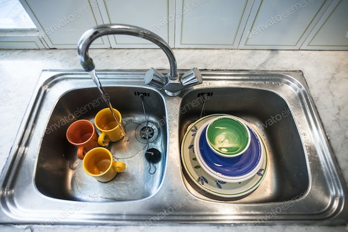 Dirty dishes in kitchen sink