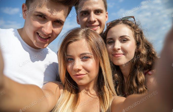 Selfie of group of teenage friends outdoor
