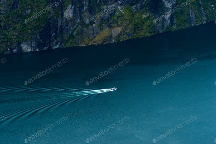 Boat making it's way in the Geiranger fjord