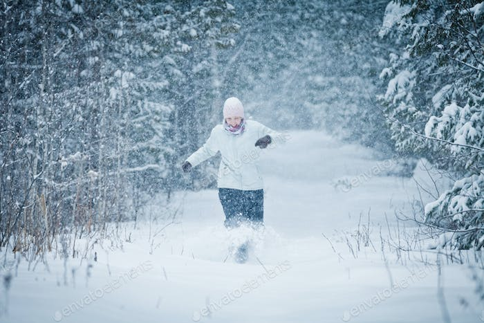 Cheerful Woman Enjoying the joys of Winter