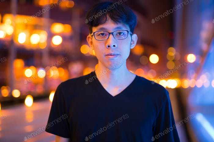Portrait Of Asian Man Outdoors At Night